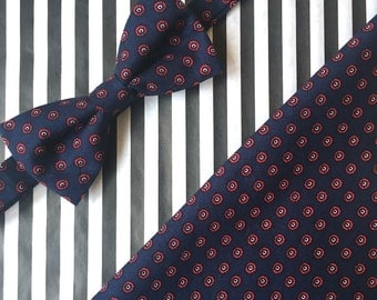 Navy blue patterned bow tie and pocket square set