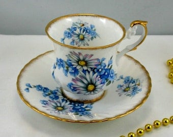 Elizabethan Teacup & Saucer,Lovely Floral Pattern on White Background, Gold Rims,Bone English China made in 1960s.