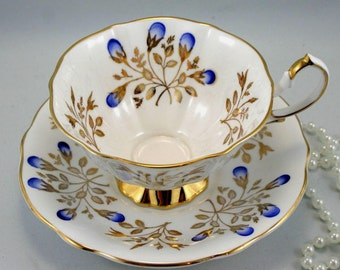 Gorgeous, Queen Anne Teacup & Saucer, Lovely, Delicate Pattern, Gold Rims, Bone China made in England in 1960s.