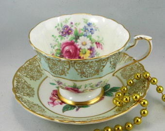 Lovely, Paragon Duo, Floral Pattern,Sky Blue Gilded Borders,Bone English China made in 1970s.
