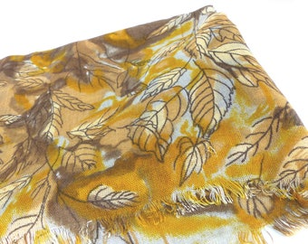 Gold and brown leaf design gauze Boho scarf shawl. Rich shades of brown and gold with artistic graphics. Shawl, wrap or neck scarf