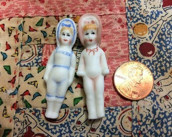 Two Miniature Bathing Penny Dolls