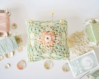 Handcrafted  light Laurel green linen pincushion with pastel Peach Orange and Flesh beige flower- crochet motif- vintage style- eco friendly