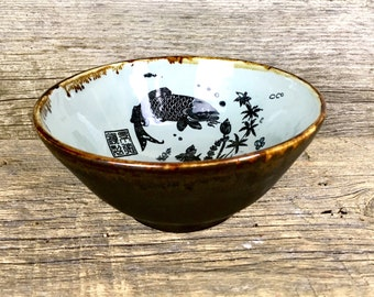 Pottery noodle soup bowl with fish