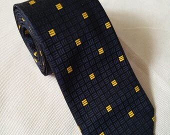 Vintage Harvie and Hudson necktie deep blue with gold bars in a geometric pattern