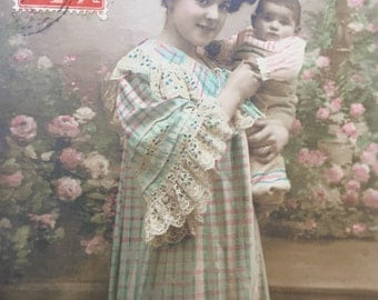 Mama holding newborn baby * Young mother and her son * Antique photograph on postcard, from France