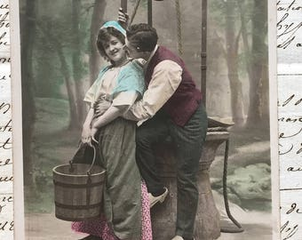 Picture on Postcard *Country couple courting by the well