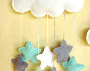 White felt cloud nursery mobile with a cascade of elephant grey and mint green stars...can be personalised