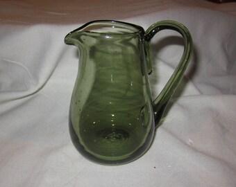 Green hand blown glass pitcher