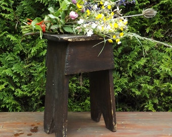 Very dark brown wooden stool rustic