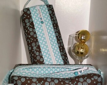 "Box Pouch - 10"" long x 5"" wide x 2.5"" tall - Brown with blue circles pattern with geometric white and blue interior/contrast"