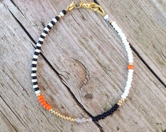 tender Bohoarmband from seed beads with orange accents
