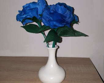 Blue roses with vase