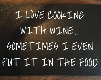 I love Cooking with Wine wooden sign.  Black and white 9.25x14