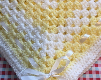 Beautiful pale yellow and white baby blanket