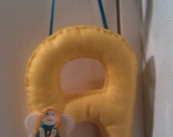 Hanging felt letters with personalised decoration