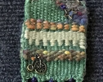 Hand Dyed Handwoven Necklace in Green Linen, Handspun wool, Brass Bike and Star Charms Copper Chain