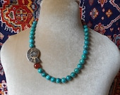Beautiful, classic ocean blue beads and fossil ammonite spiral necklace