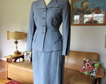 High quality tailored 1950s pale blue skirt suit made with a thick gabardine white and dark blue flecks atomic fabric.