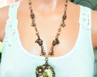 Assemblage Necklace with a floral cameo and Chocolate brass stamping, Matching Earrings