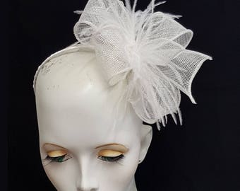 White sinamay and feather fascinator on headband fixing ideal weddings races