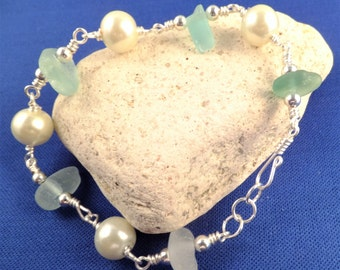 Shades of green beach glass bracelet with faux pearl, silver plated wire