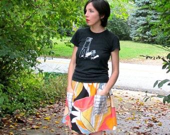 S. Mod skirt in vintage linen. Elastic waist. Roomy organza pockets with geometric print.