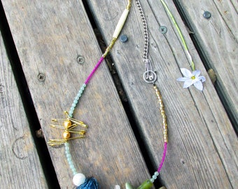 Cinderella necklace, gemstones, delica beads, chain, wire ball, and gold safety pins