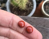 2 stones. Small red jasper rounds. Pair. Earring set. Smooth round cabochons. rust, red, orange gemstone. Jasper rounds. Tiny oval stones.