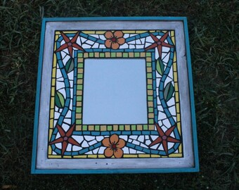 "Mosaic Mirror, 24""x24"". Available at Port Aransas Art Center, Flowers, Ceramic tile mosaic mirror, hand cut tropical mosaic by Janet Dineen"