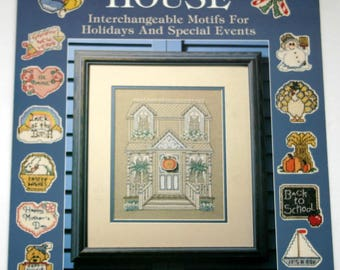 """Counted Cross Stitch booklet """"Holiday House"""" Christmas, Easter, Halloween, Valentine's Day etc.  1990"""