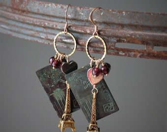 Amorette Earrings: Stunning brass Eiffel towers dangle w patina brass love notes, pyrite hearts and garnet drops on 14k gold filled ear wire