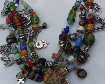 Handmade strands glass beads and some sterling charms bracelet