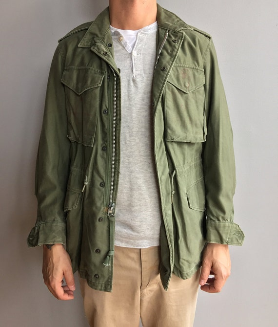 Faded M-1951 Olive Green Field Jacket with four front pockets. Regular Small. Artwork