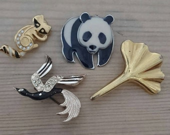 Vintage lot of four brooches