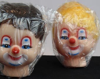 Two Scary Clown Heads with Hair