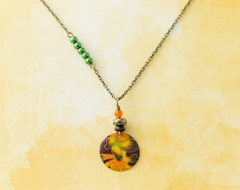 Floral Flower Vintage Tin Pendant Asymmetrical Charm Necklace with Green and Orange Beads and Antique Brass Chain Jewelry