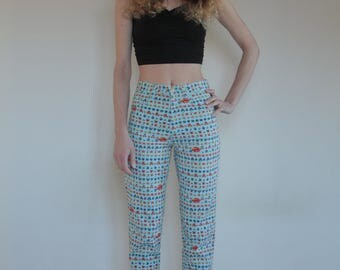 90's Versace young blue flower printed jeans, small size