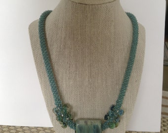 Kumihimo necklace with glass focal bead