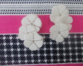50s - 60s Mid Century soft white plastic and diamante statement clip on flower earrings. Ear creeper style. New old stock.