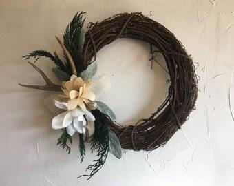 Rustic, handmade deer antler wreath
