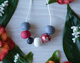 Alexandra—Handmade necklace with red black white and granite polymer clay beads