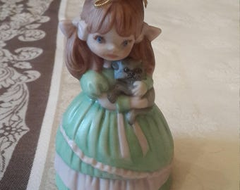 Girl holding cat Ceramic figurine bell green and pink dress