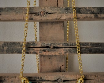 Turquoise knitting wool and brass necklace