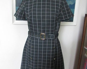 1960s charcoal grey check funnel neck dress with front button & kick pleat detail