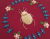 Anthophagy - Goldwork Beetle with Floral Beadwork Wreath
