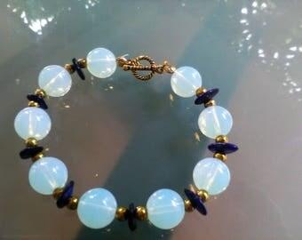 Moonstone gemstone bracelet, gold Hematite & purple mother of Pearl