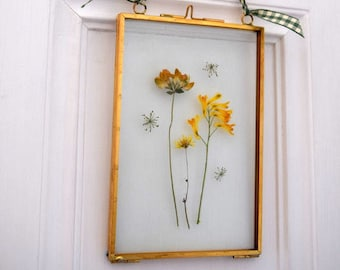 Beautiful pressed flower picture in double sided glass and brass picture frame