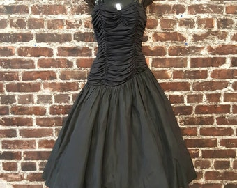 1950s Black Prom Dress. Black 50s Party Dress. Full Skirt with Sweetheart Neckline, Sequin Straps, Asymmetrical Ruched Bustier.