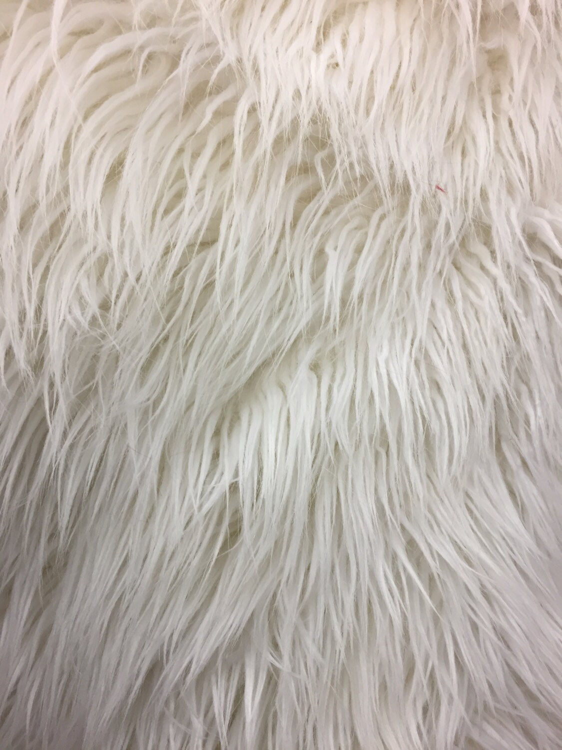 white long pile mongolian faux fur fabric sold by the yard. Black Bedroom Furniture Sets. Home Design Ideas